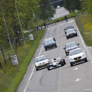 F1 Racing Car On The Highway ( Driver Jos Verstappen )