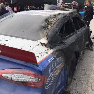 Brian Finney extinguishes his own fire at Toledo Speedway