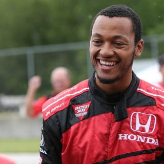 Green Bay Packers quarterback Brett Hundley takes a ride in an INDYCAR at Road America with Mario Andretti
