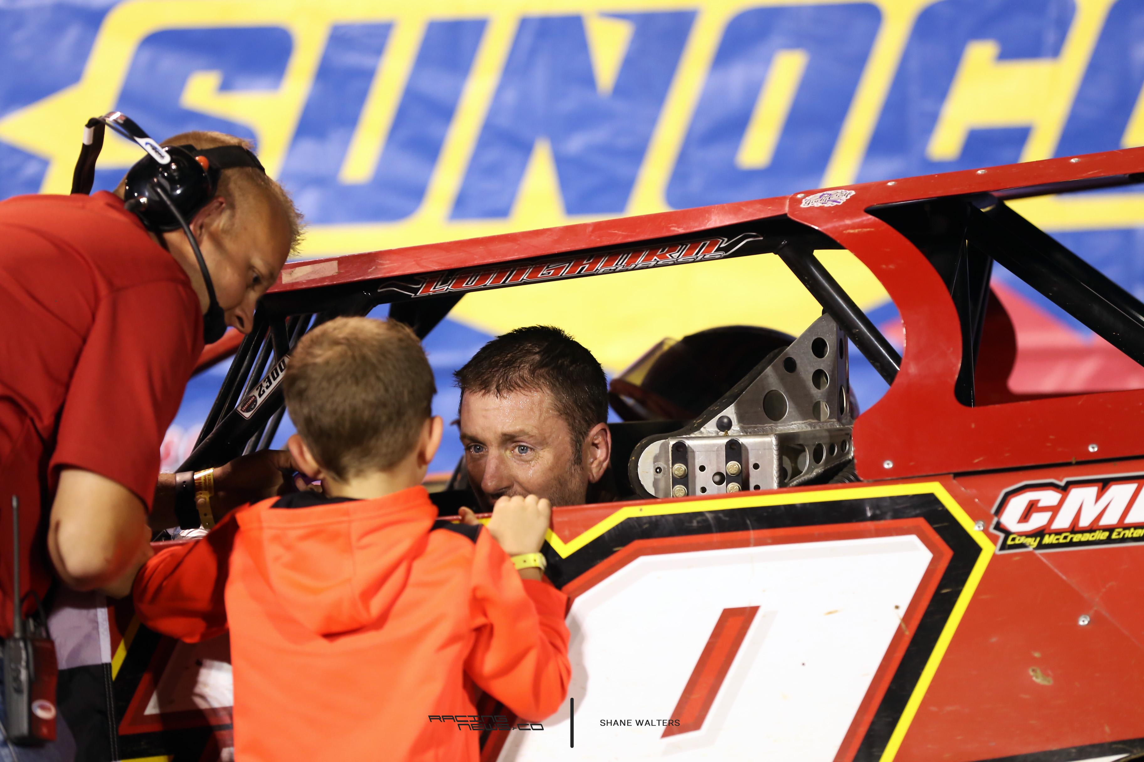 Tim McCreadie talks to his son 4792