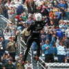 Noah Gragson climbs the fence at Martinsville Speedway