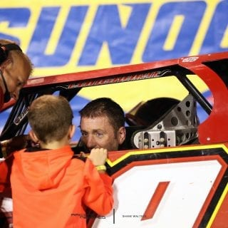 Tim McCreadie talks to his son after winning the North/South 100