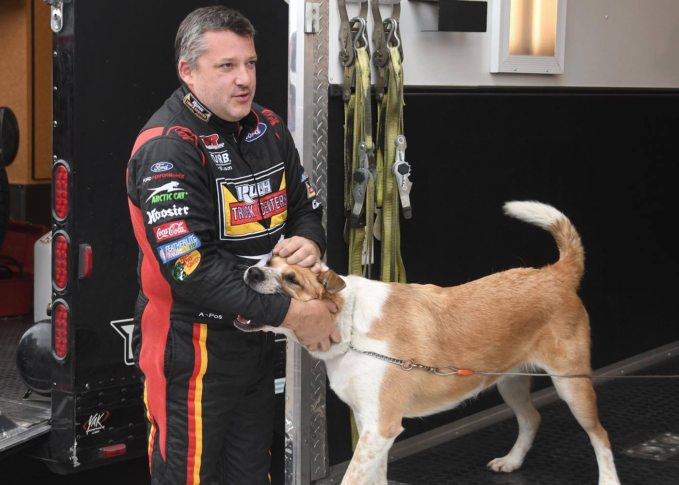 Tony Stewart and his dog pictured at the dirt track
