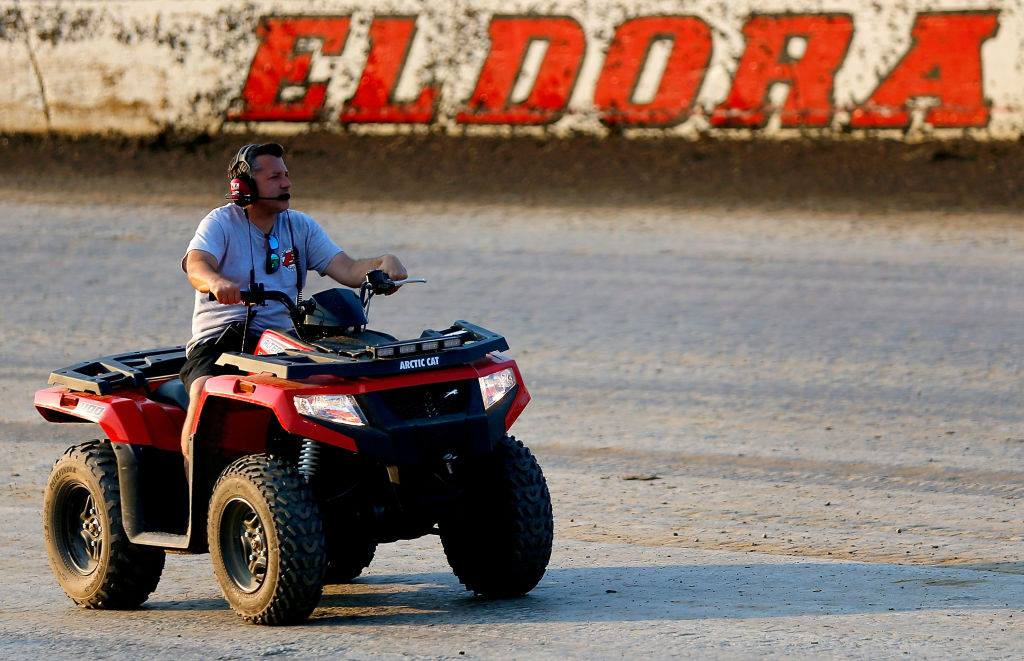 Tony Stewart checks the surface at Eldora Speedway