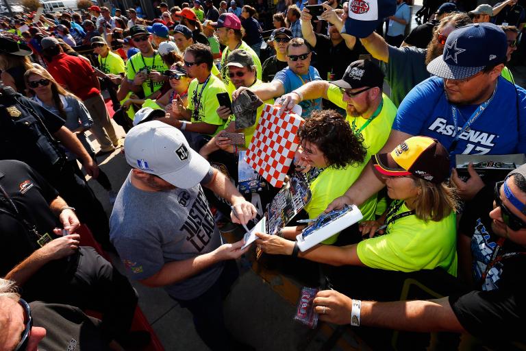 Dale Earnhardt Jr signs autographs