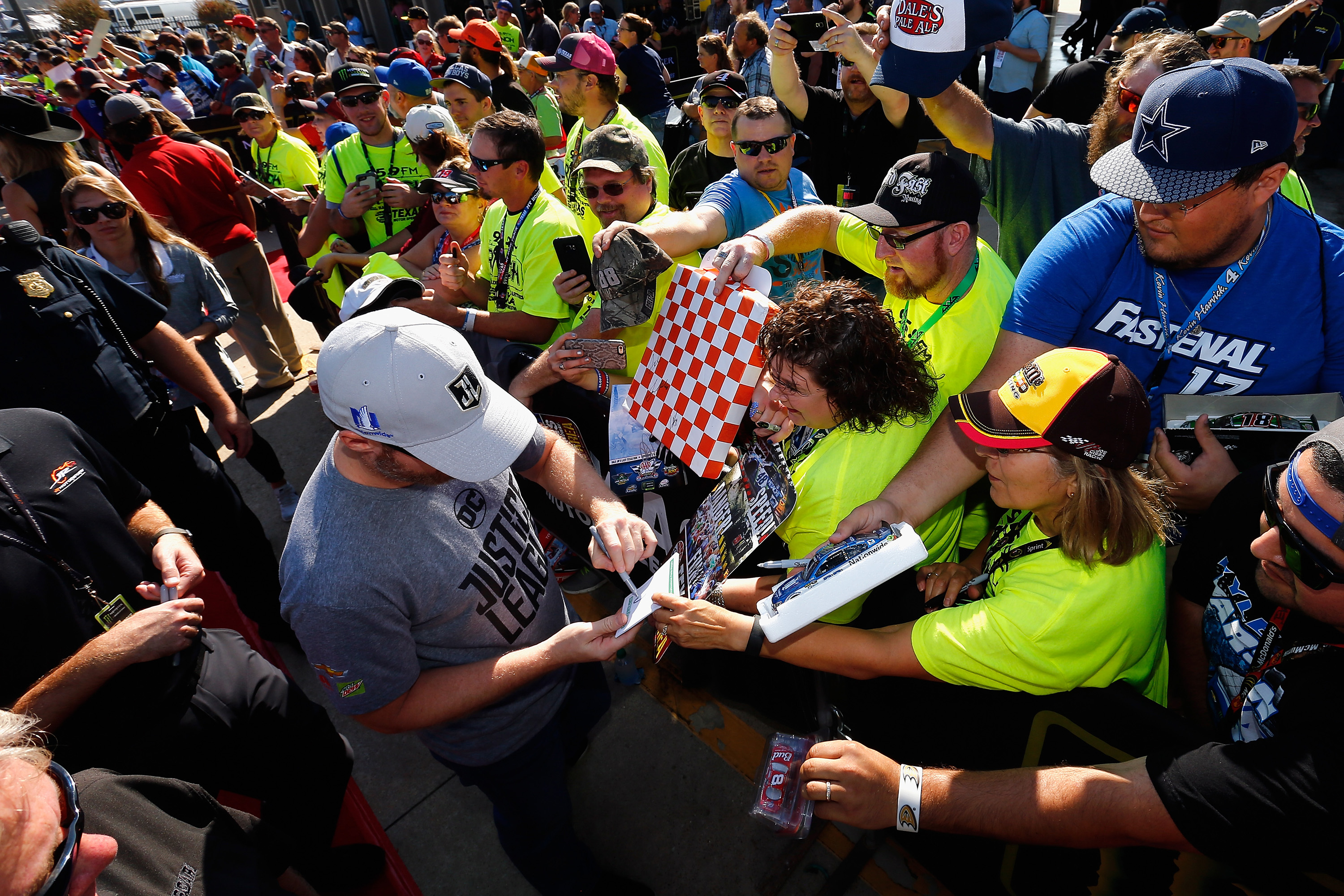 Dale Earnhardt Jr signs autographs