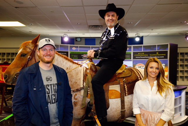 Eddie Gossage on a horse in the media center at Texas Motor Speedway