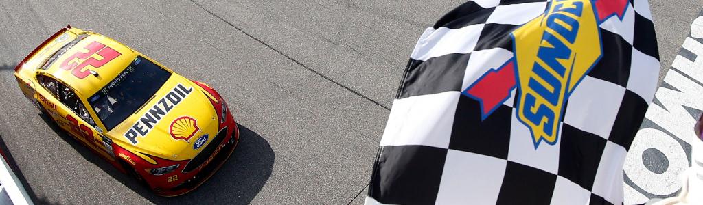 NASCAR president Brent Dewar speaks on stage racing