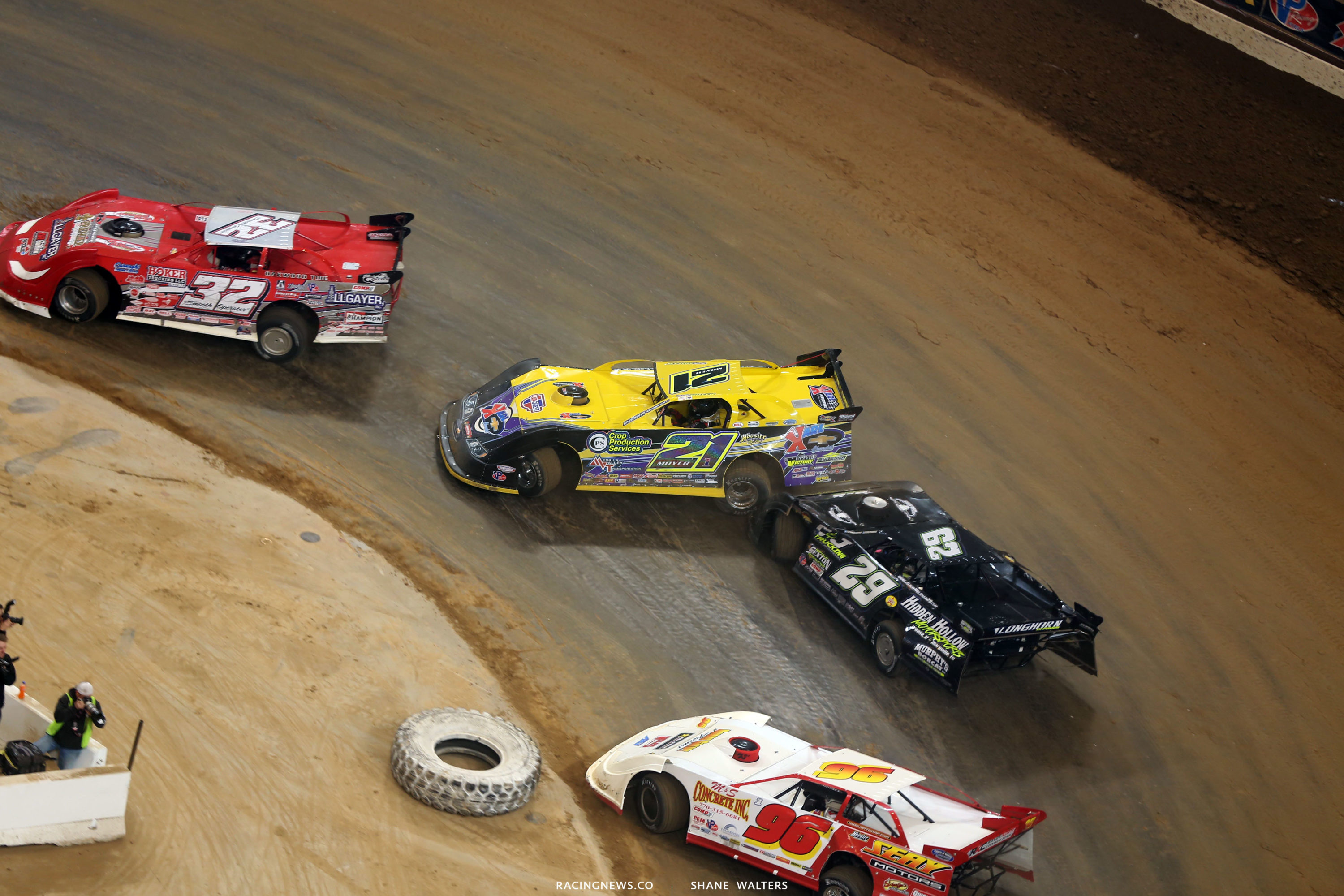 Bobby Pierce, Billy Moyer Sr, Billy Welshan and Tanner English run the bottom in turn 1 5245