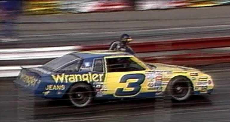 Dale Earnhardt Sr cleans his windshield during the race
