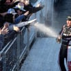 Clint Bowyer sprays champagne on the fans
