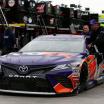 Denny Hamlin crew push the #11 race car through garage area