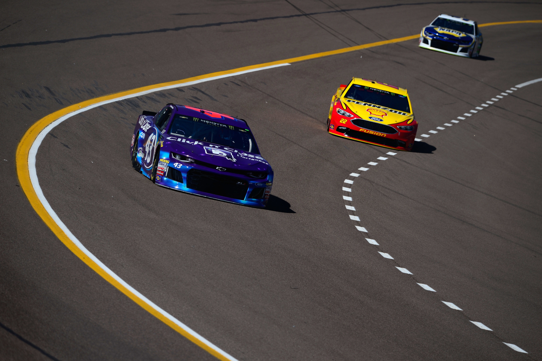 ISM Raceway dogleg photo - Darrell Wallace Jr and Joey Logano