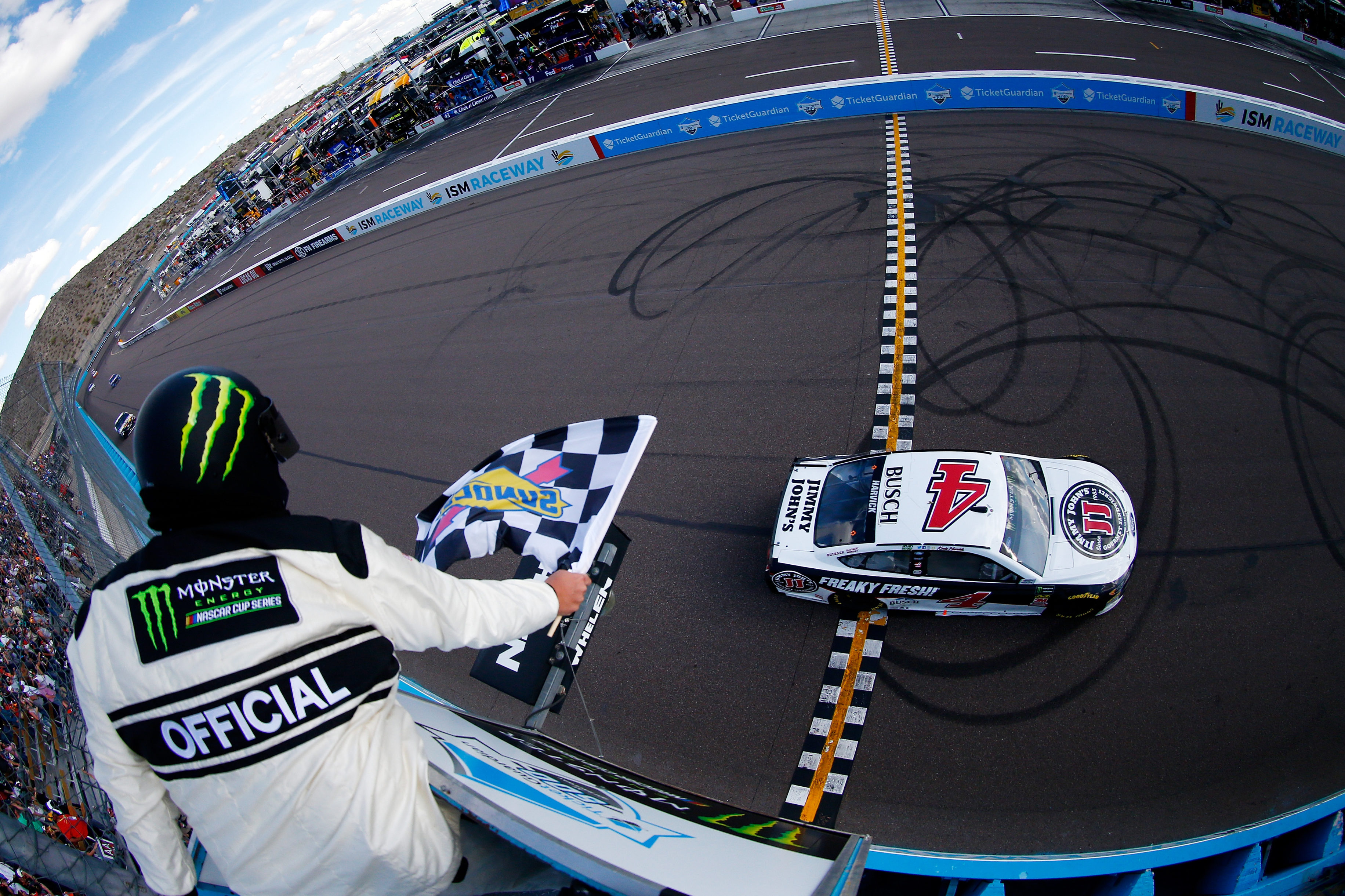 Kevin Harvick wins the Monster Energy NASCAR Cup Series event at ISM Raceway