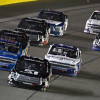 Kyle Busch, Stewart Freisen and Johnny Sauter race for the lead in the NASCAR Truck Series race at Las Vegas Motor Speedway