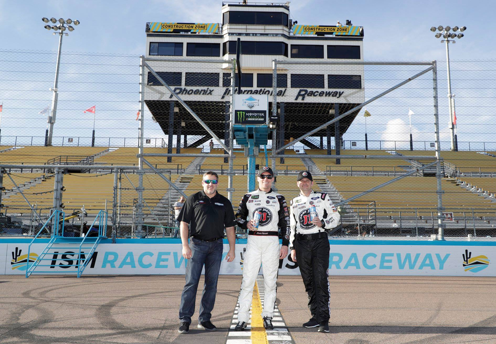 Tony Stewart, Kevin Harvick and Rodney Childers at the ISM Raceway start-finish line in 2018