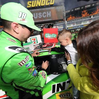 Kyle Busch, Brexton Busch and Samantha Busch in victory lane