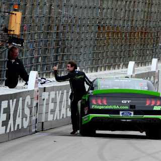 Ryan Blaney hands off the flag at Texas Motor Speedway - NXS