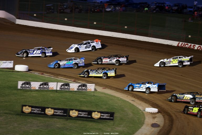 Austin Siebert, Jonathan Davenport and Austin Rettig lead them into turn 1 at Lucas Oil Speedway 7701