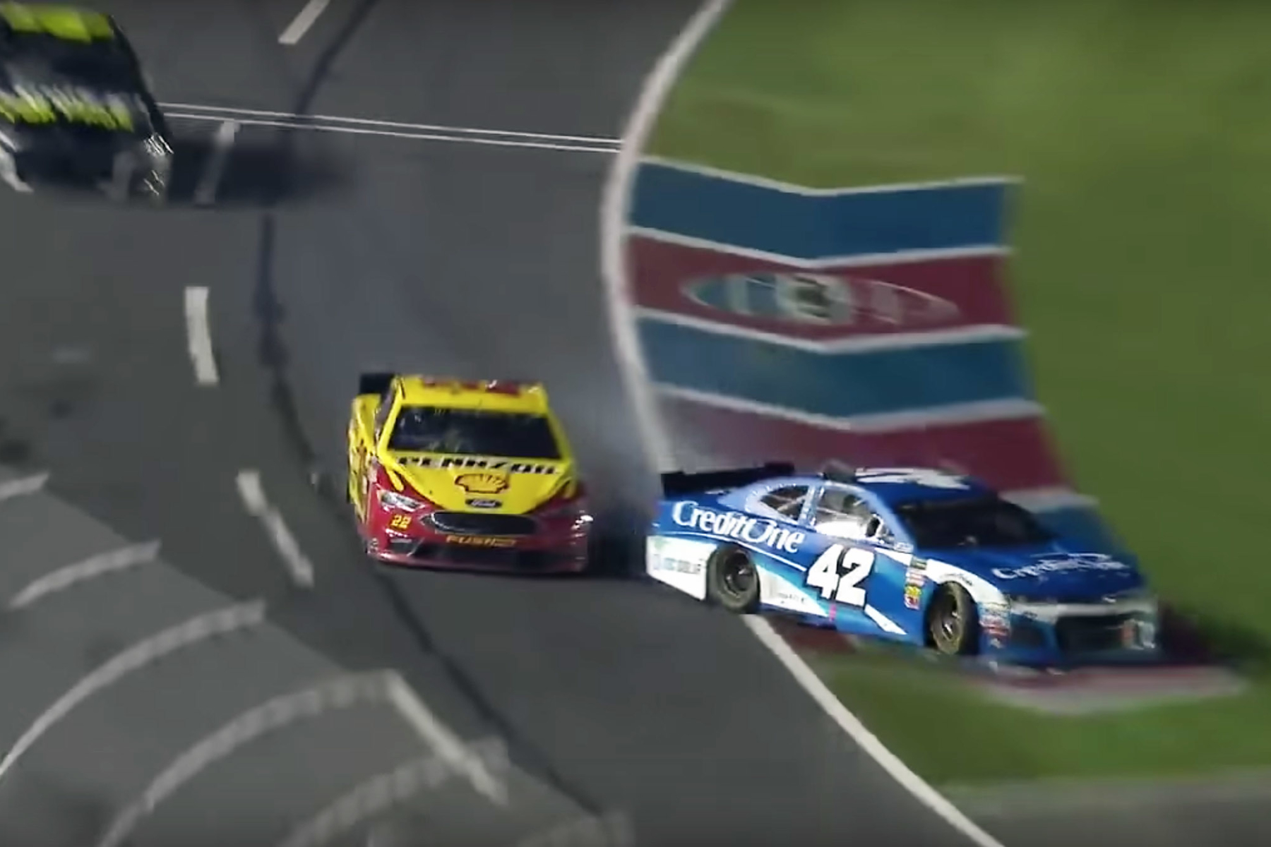 Joey Logano and Kyle Larson at Charlotte Motor Speedway