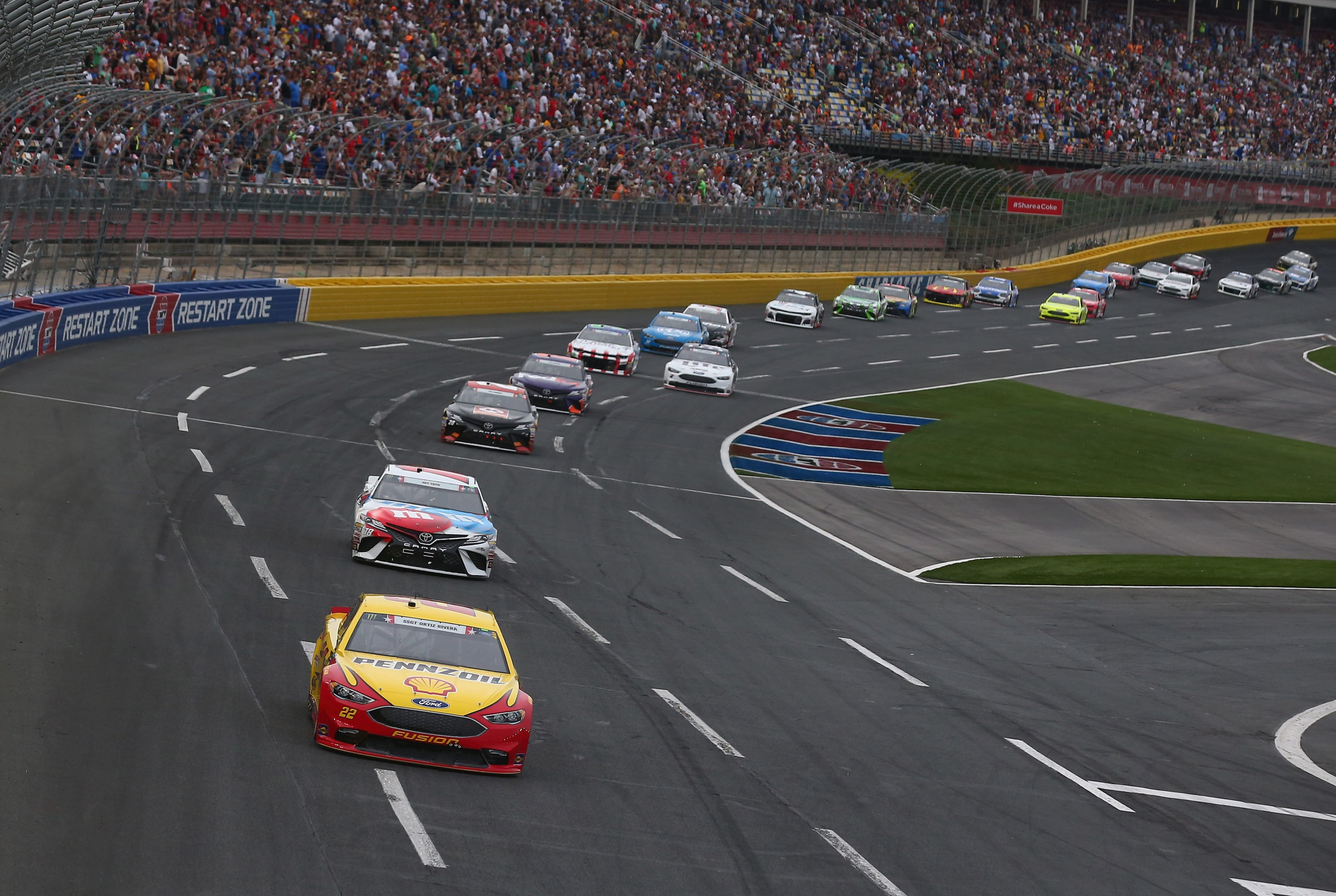 Joey Logano leads Kyle Busch in the Coca-Cola 600 at Charlotte Motor Speedway