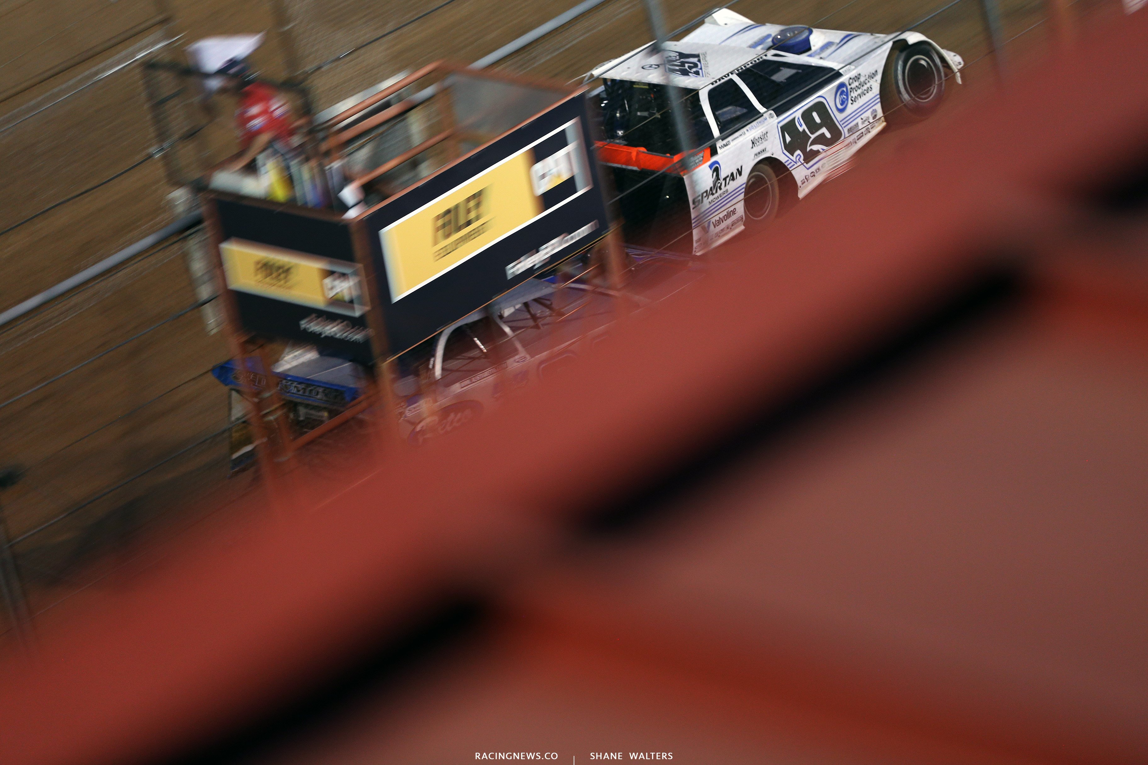 Jonathan Davenport and Austin Rettig take the white fag at Lucas Oil Speedway 7710