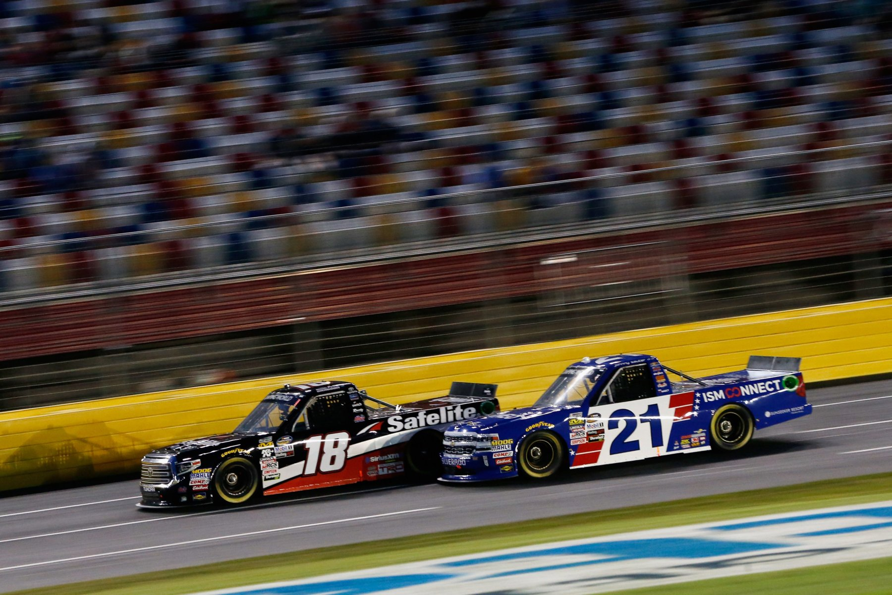 Kyle Busch and Johnny Sauter at Charlotte Motor Speedway