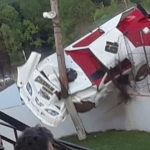 Lake Cumberland Speedway crash - Race car climbs catch fence