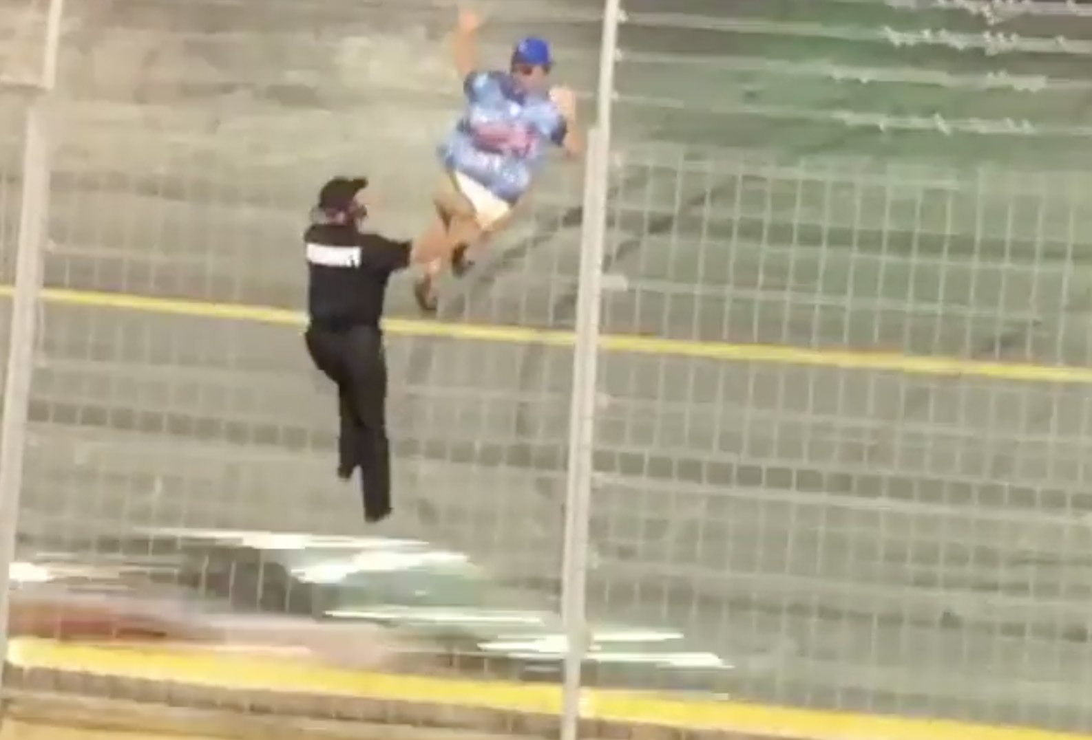 NASCAR fan climbs the fence in the Coca-Cola 600