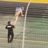 NASCAR fan clinbs the fence at Charlotte Motor Speedway