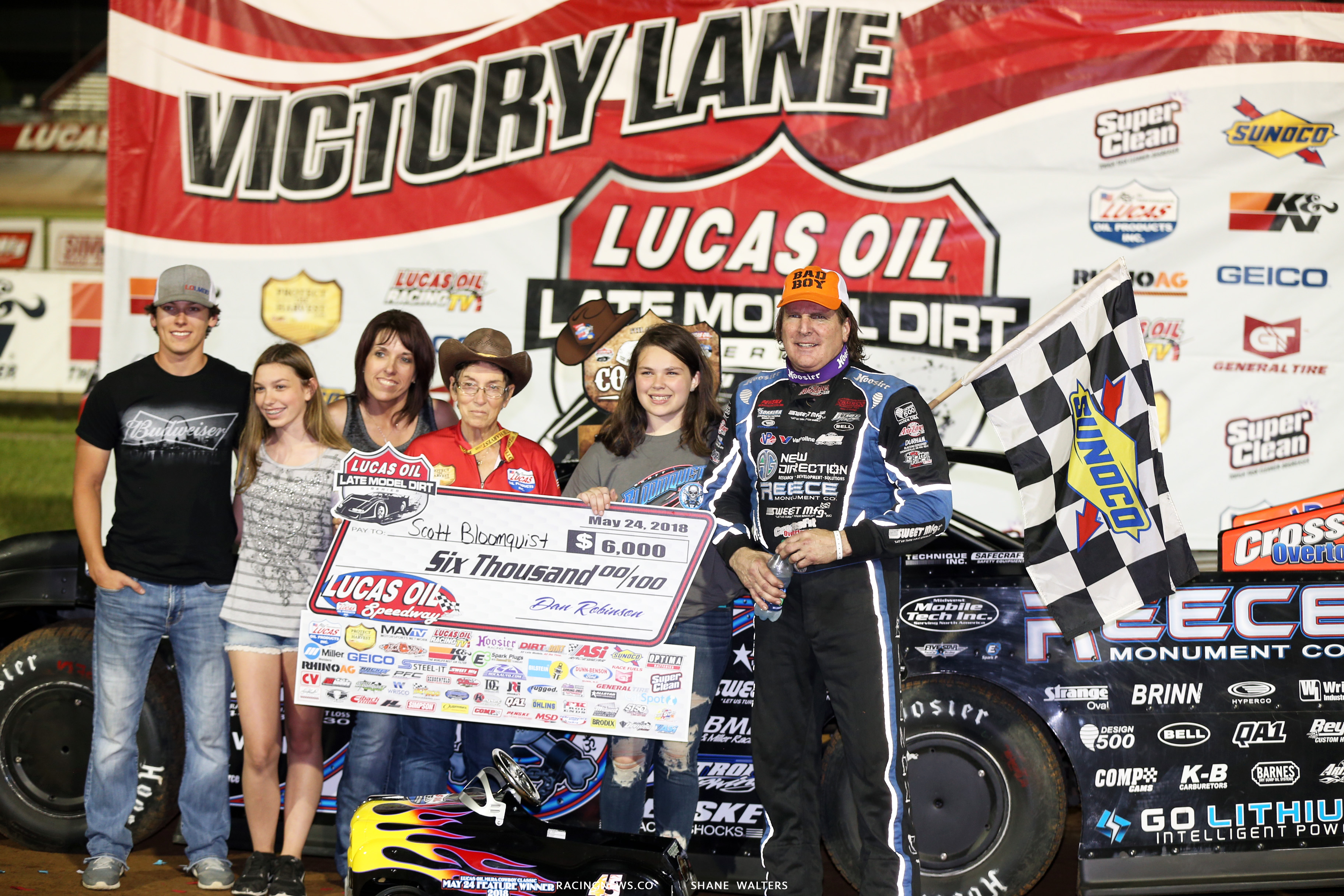 Scott Bloomquist and his daughter Ariel Bloomquist in victory lane 7956