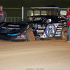 Scott Bloomquist breaks the left front wheel at Lucas Oil Speedway 8444