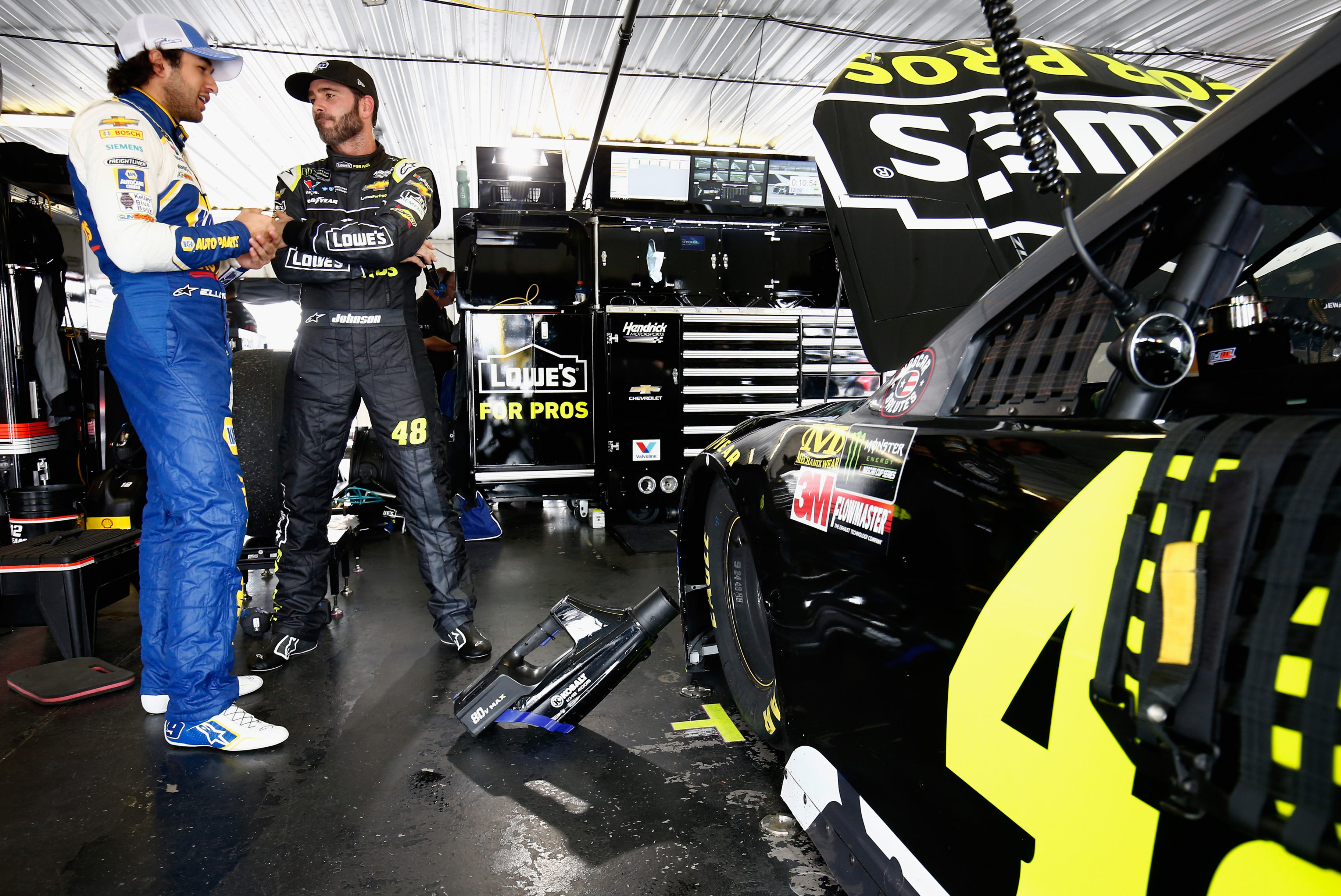 Chase Elliott and Jimmie Johnson in the NASCAR garage