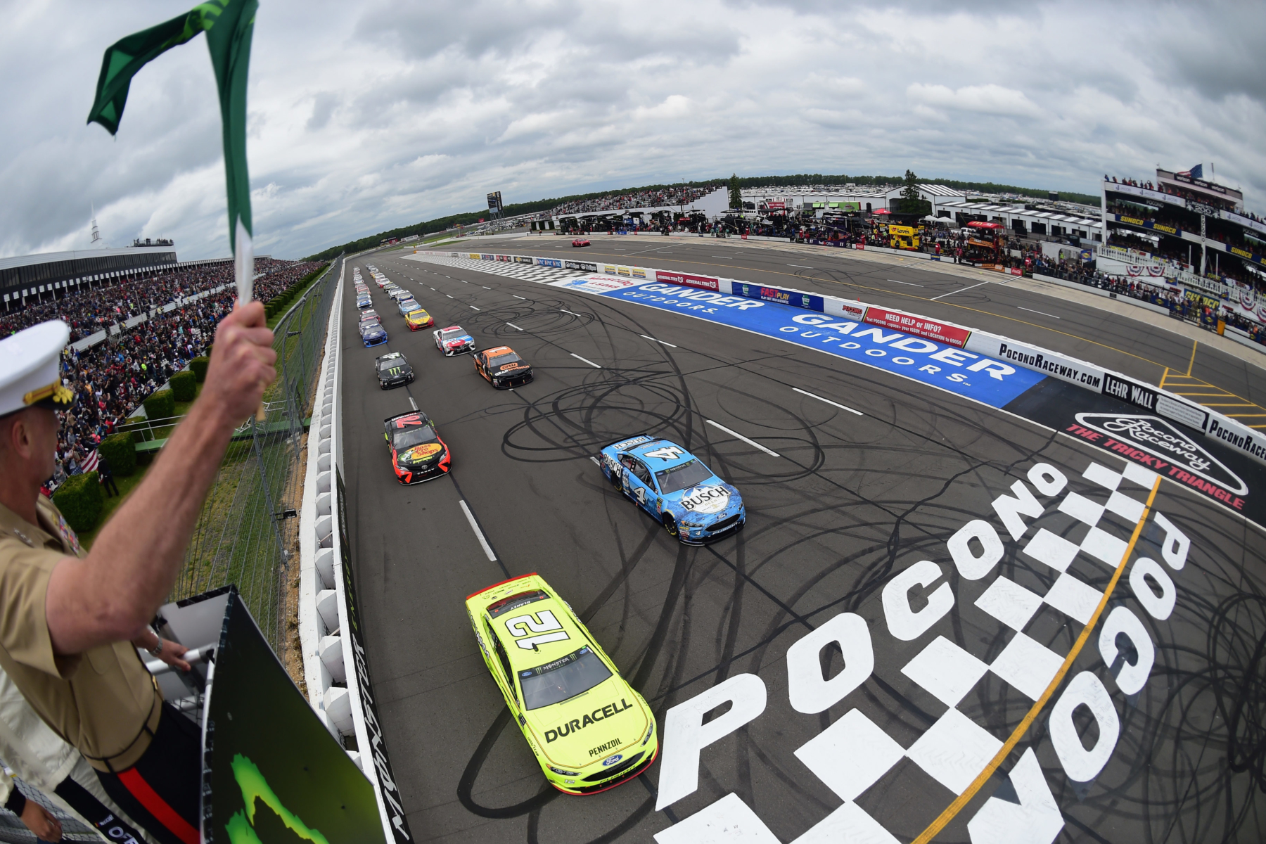 Ryan Blaney and Kevin Harvick lead them to the green at Pocono Raceway
