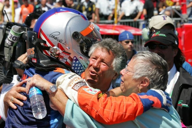 Mario Andretti and Dee Ann Andretti celebrate the first win of their grandson Marco Andretti