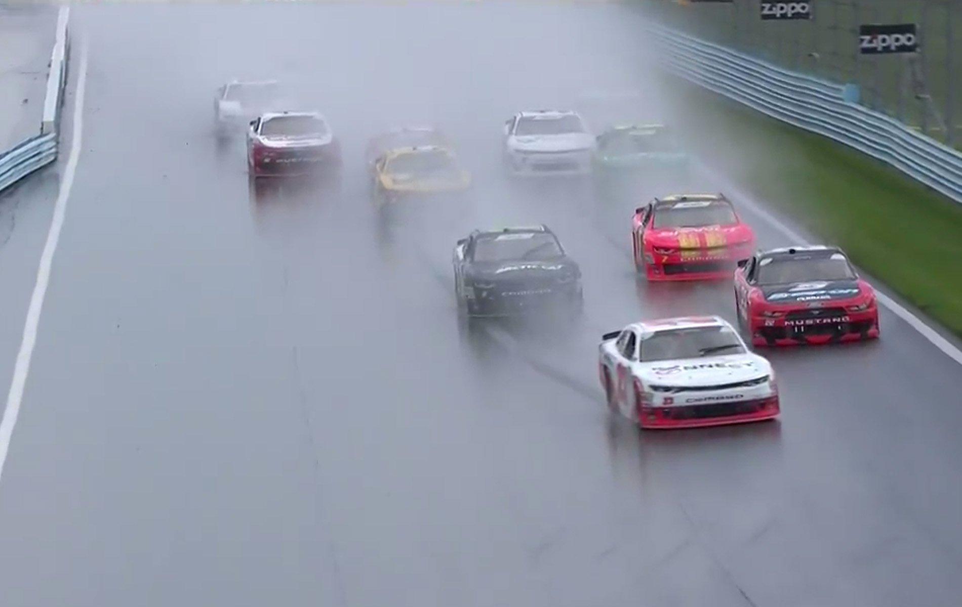 AJ Allmendinger leads in the rain