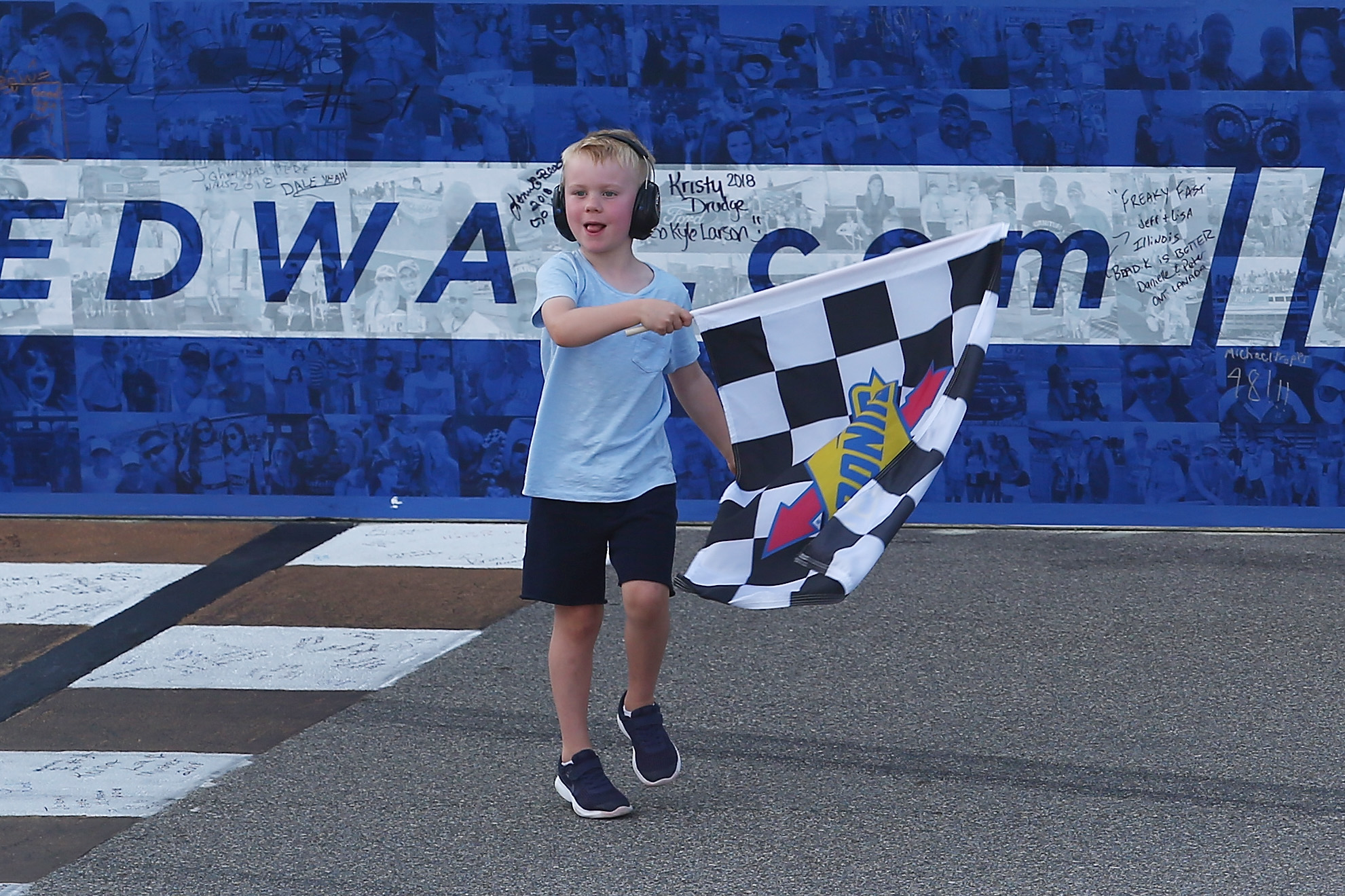 Keelan Harvick takes the flag after his dad wins Michigan