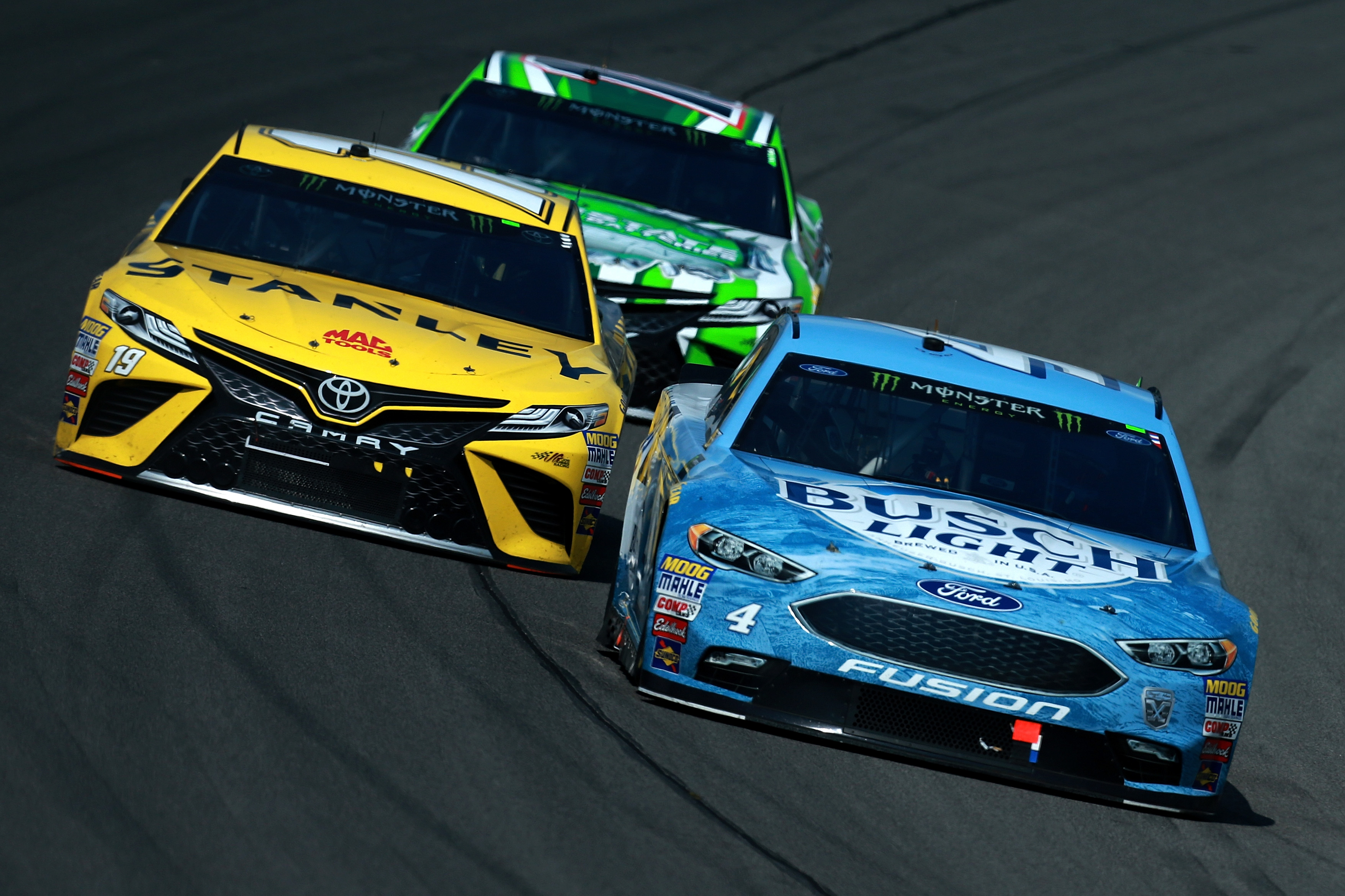 Kevin Harvick, Daniel Suarez and Kyle Busch at Michigan International Speedway