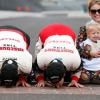 Brad Keselowski kisses the bricks at Indianapolis Motor Speedway