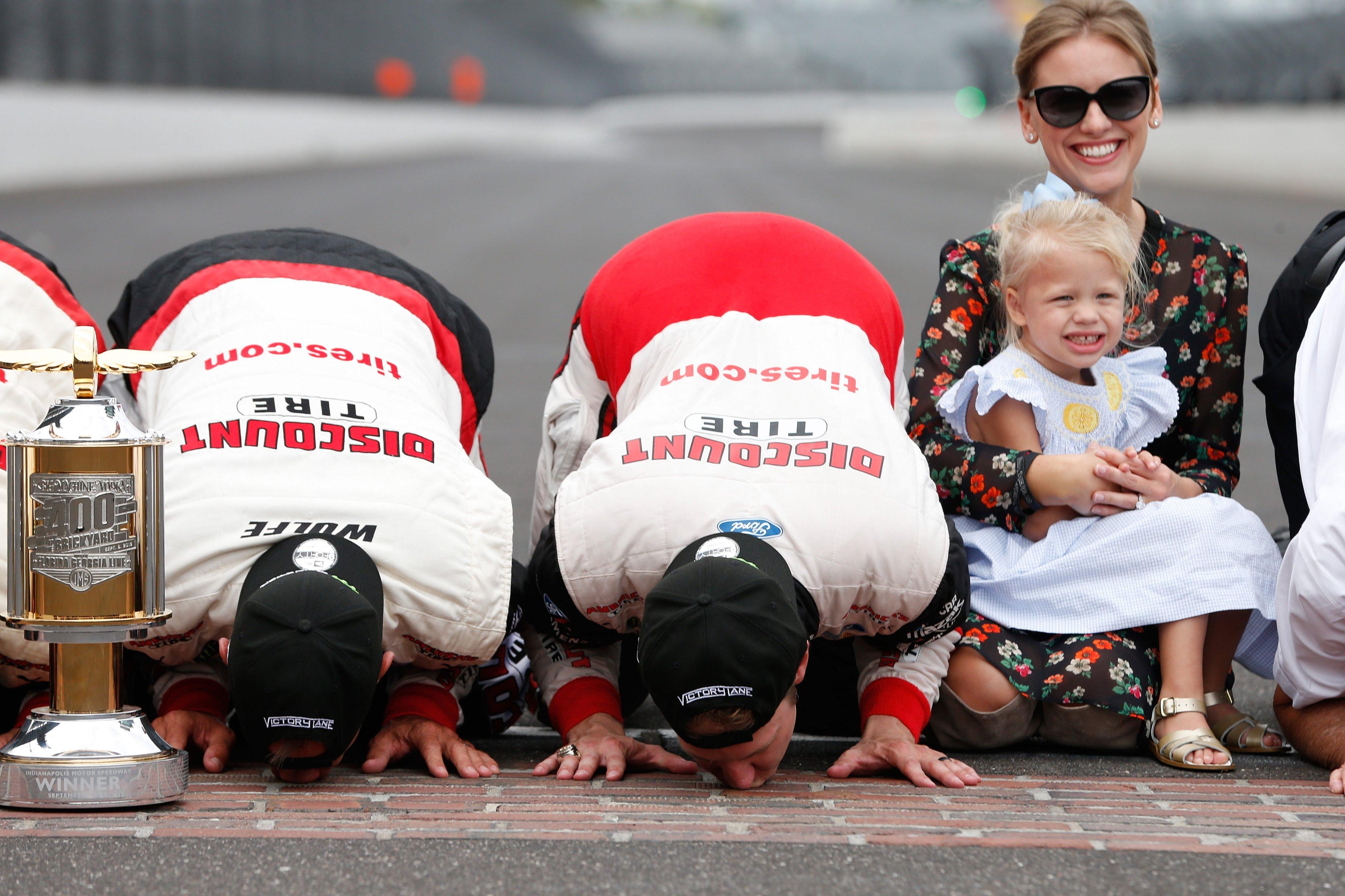 Brad Keselowski kisses the bricks at Indianapolis Motor Speedway