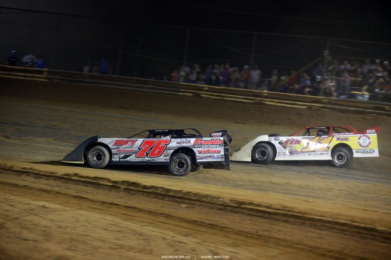 Brandon Overton and Jared Hawkins race for the lead at Tyler County Speedway 8063