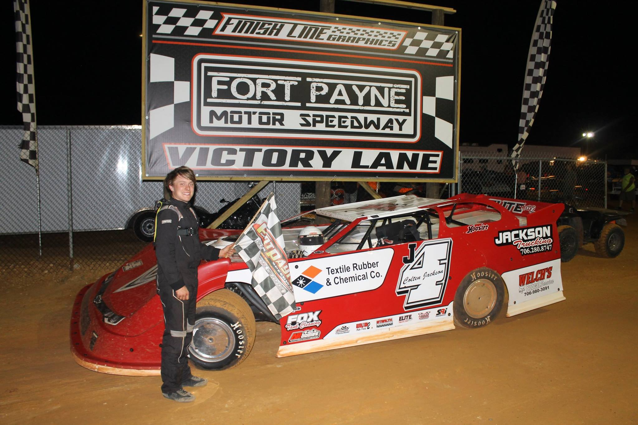 Colten Jackson in victory lane at Fort Payne Motor Speedway