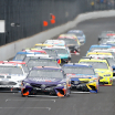 Denny Hamlin leads Clint Bowyer and Kyle Busch at Indianapolis Motor Speedway