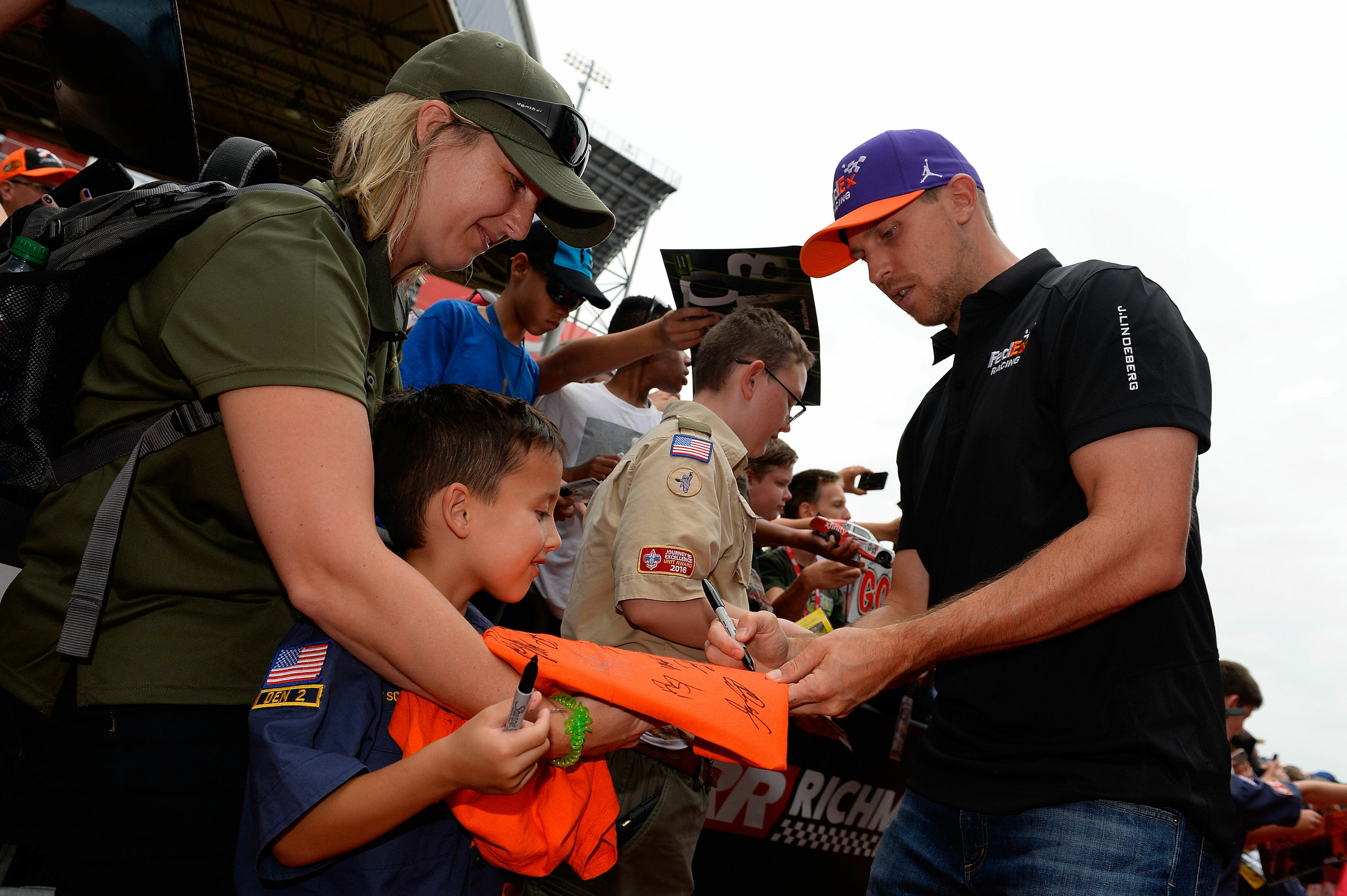 Denny Hamlin signs autographs for NASCAR fans at Richmond Raceway
