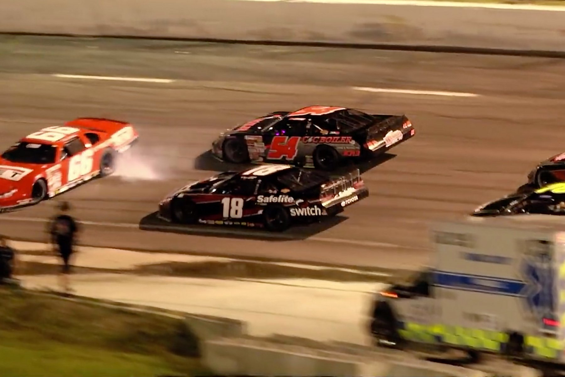 Steve Wallace vs Raphael Lessard in the CARS Tour race at Orange County Speedway