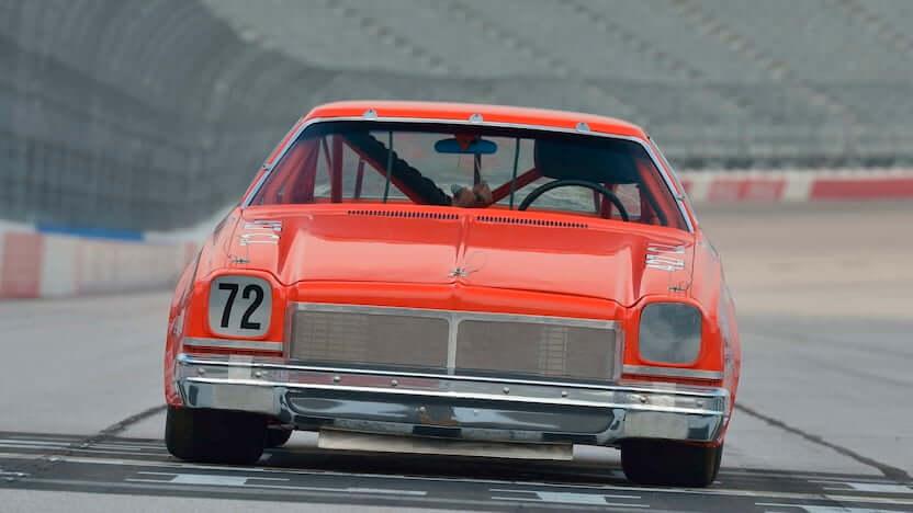NASCAR race car heading the auto auction after former crew