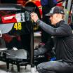Jimmie Johnson in the NASCAR garage area at Kansas Speedway