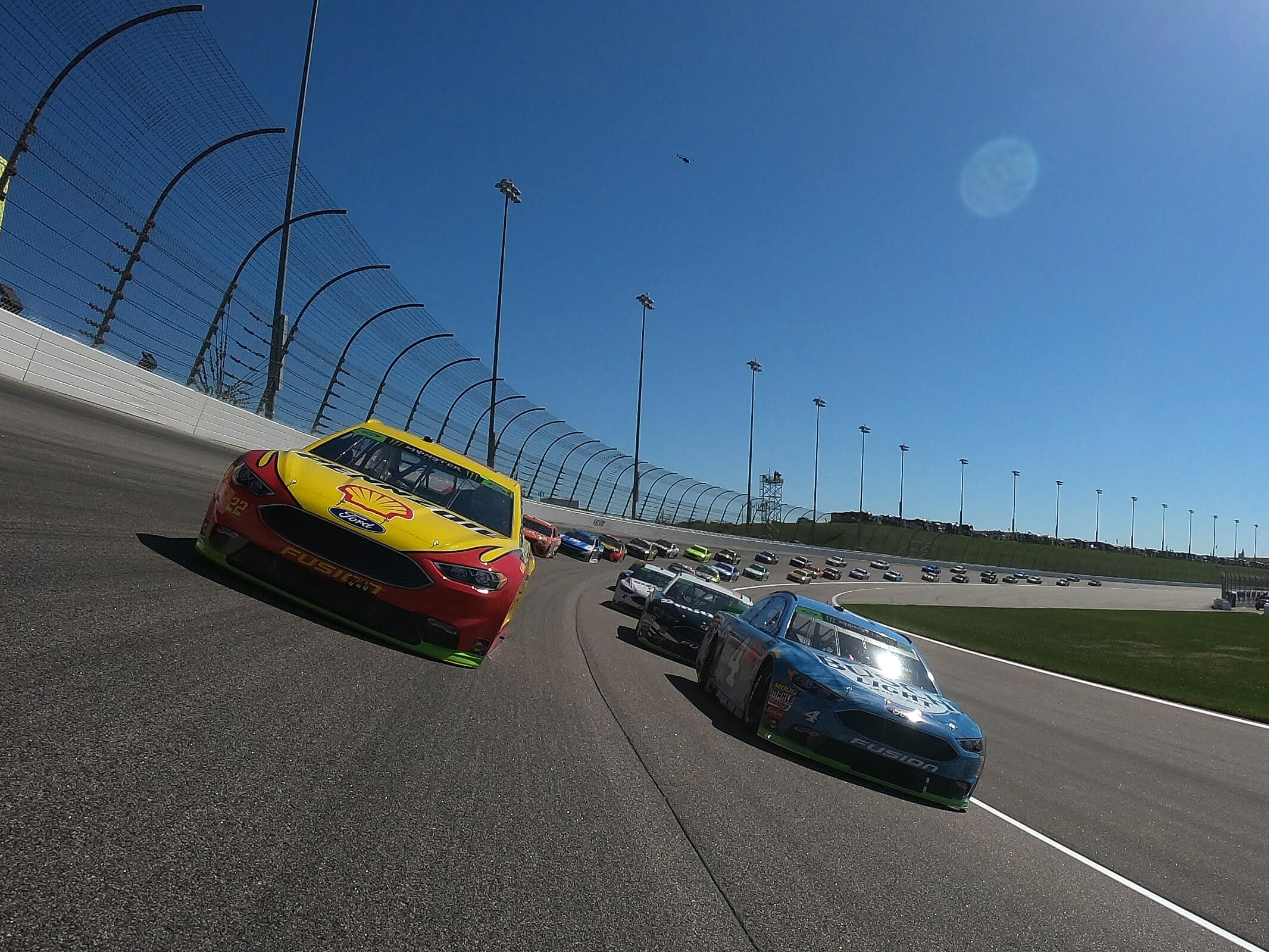 Joey Logano and Kevin Harvick at Kansas Speedway