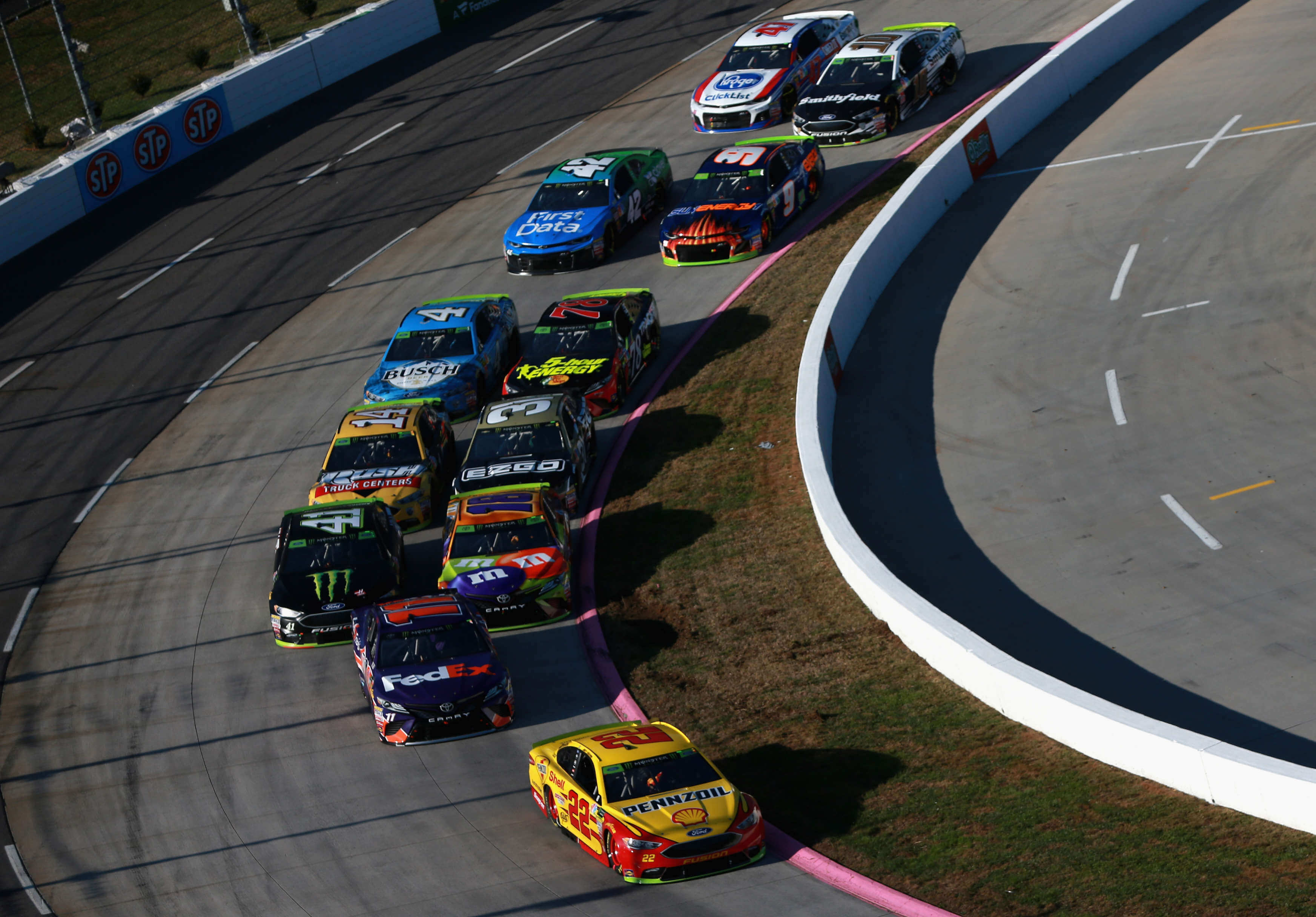 Joey Logano leads Denny Hamlin, Kyle Busch and Kurt Busch, Ryan Newman, Clint Bowyer, Martin Truex Jr, Kevin Harvick and CHase Elliott at Martinsville Speedway - NASCAR