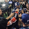 Elliott Sadler shares beer with his crew after his final NASCAR race